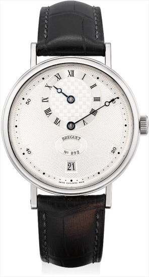 A fine platinum wristwatch with regulator dial and date