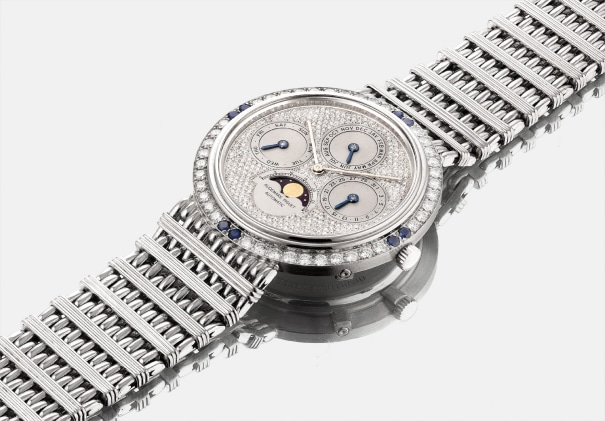 A fine and rare platinum, diamond and sapphire-set perpetual calendar bracelet watch with moon phases