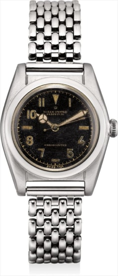 A rare and attractive stainless steel wristwatch with sweep centre seconds, black lacquer dial and bracelet