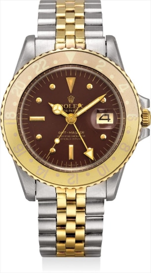 A yellow gold and stainless steel dual time wristwatch with sweep centre seconds, date, nipple dial and bracelet