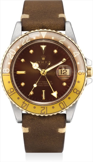 A yellow gold and stainless steel dual time wristwatch with sweep centre seconds and date