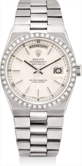 A fine and rare white gold and diamond-set calendar wristwatch with sweep centre seconds and bracelet
