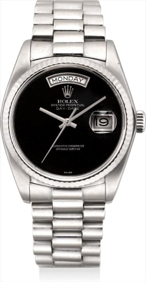 An extremely rare white gold calendar wristwatch with sweep centre seconds, onyx dial and bracelet