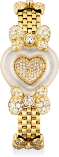 A lady's fine yellow gold and diamond-set heart-shaped bracelet watch with mother-of-pearl bezel