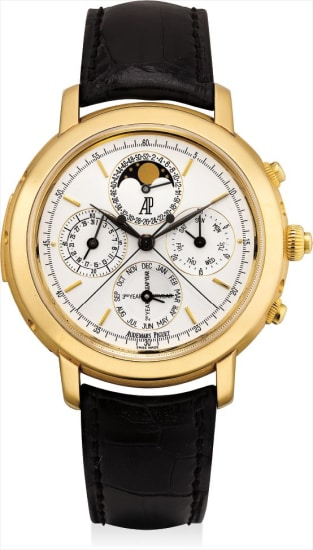 A very fine and extremely rare yellow gold minute repeating perpetual calendar split seconds chronograph wristwatch with moon phases, calendar week and leap year indicator