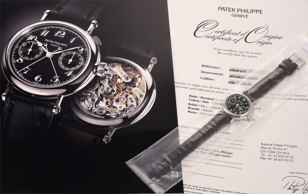 A very fine and very rare platinum split seconds chronograph wristwatch with black dial, original certificate and fitted presentation box, factory sealed