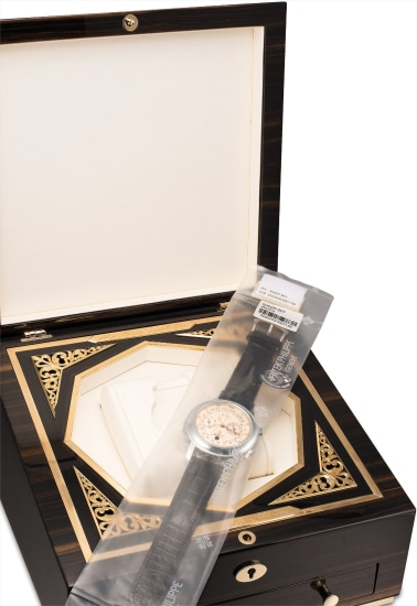 A highly important, impressive and extremely rare platinum double dialed wristwatch with twelve complications including minute repeating, tourbillon, perpetual calendar, retrograde date, sky chart, moon phases, orbit display, sidereal time, leap year indicator, with original certificate and fitted presentation box, factory sealed