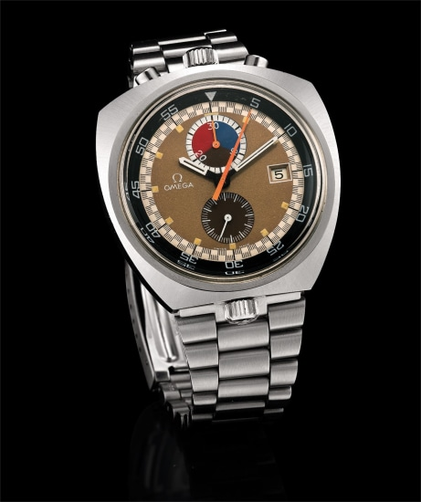 An extremely rare, unusual and oversized asymmetrical stainless steel chronograph wristwatch with gold and brown tropical dial, date, revolving inner bezel and bracelet