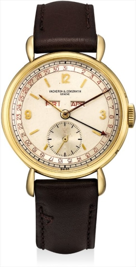 A rare yellow gold triple calendar wristwatch with two-tone dial and tear-drop lugs