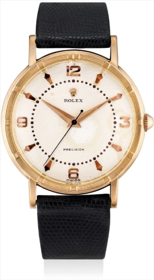 A rare 14k pink gold wristwatch with sweep centre seconds and ivory honeycomb dial