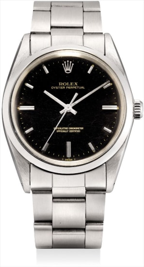 A rare stainless steel wristwatch with sweep centre seconds, black lacquer dial and bracelet