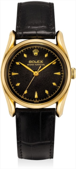 A rare yellow gold wristwatch with sweep centre seconds, black lacquer dial and bombe case