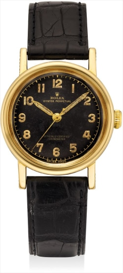 A rare yellow gold wristwatch with sweep centre seconds and black lacquer dial