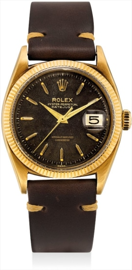A fine and rare yellow gold wristwatch with sweep centre seconds, date and black lacquer dial