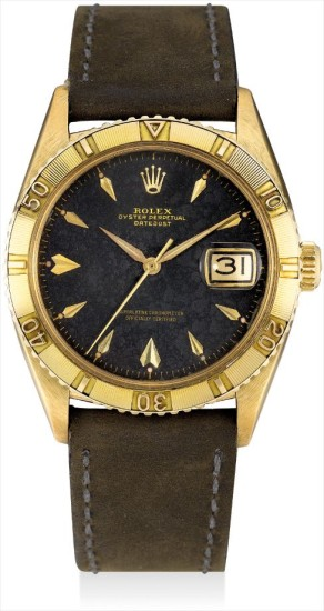 A fine and rare yellow gold wristwatch with sweep centre seconds, date, black lacquer dial and calibrated revolving bezel
