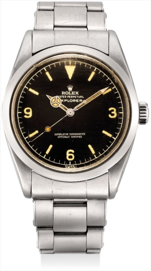 A rare stainless steel wristwatch with sweep centre seconds, black lacquer 'explorer' dial, bracelet, original guarantee and fitted presentation box