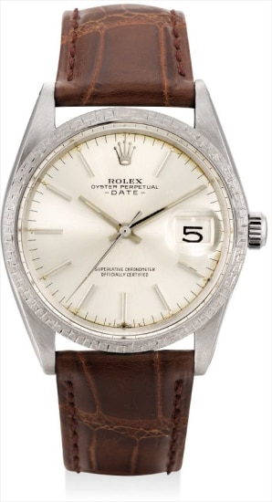 A rare white gold wristwatch with sweep centre seconds, date and textured bezel