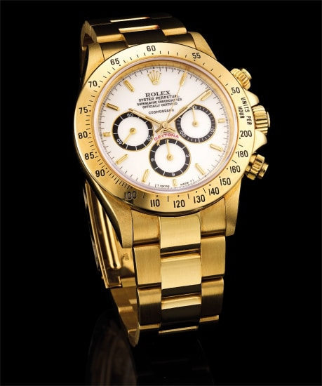 A fine and rare yellow gold chronograph wristwatch with porcelain dial, suspended logo and bracelet