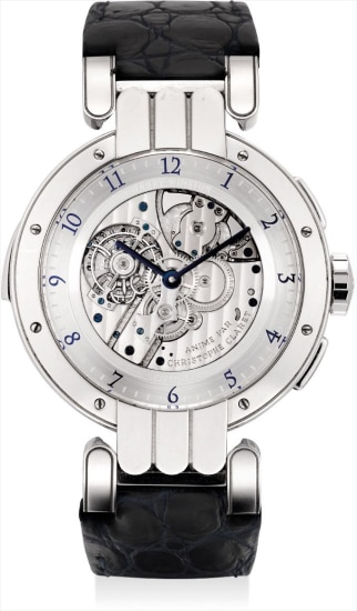 An extremely rare, very fine and large platinum limited edition reversible minute repeating tourbillon double dialed wristwatch with date and moon phases