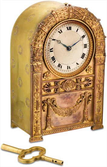 A very rare brass empire ormolu clock with hour repeating on demand or automatically, alarm, 8 day movement and original key