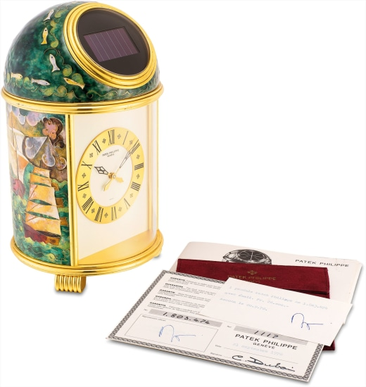 An extremely fine and unique gilt brass solar power dome table clock with cloisonné enamel by Elisabeth Perusset Lagger, original certificate and retail card