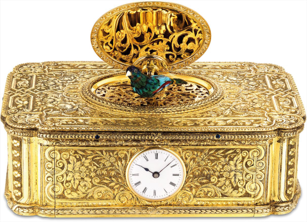 An exceptional and extraordinarily rare silver gilt and enamel singing bird box with watch