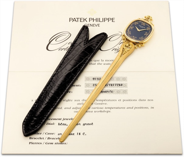A very fine and extremely rare yellow gold paper knife with watch, original certificate and travel case
