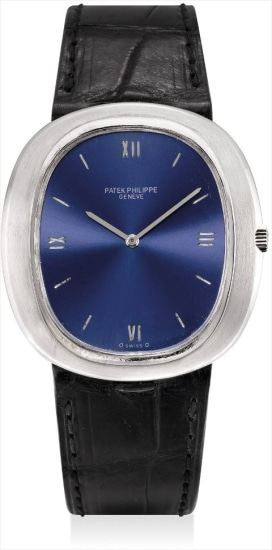 A fine white gold oval wristwatch with Roman numerals