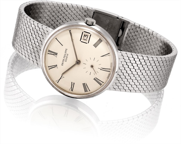 A rare white gold bracelet watch with date
