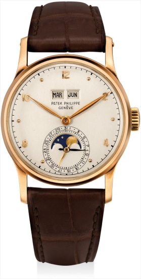 A very fine and very rare pink gold perpetual calendar wristwatch with moon phases