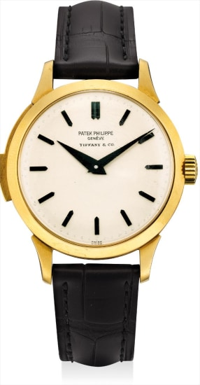 A historically important and unique yellow gold minute repeating wristwatch with oversized repeating trigger, blackened hands and numerals, retailed by Tiffany & Co.