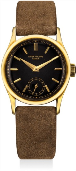 A fine and rare yellow gold wristwatch with black lacquer dial