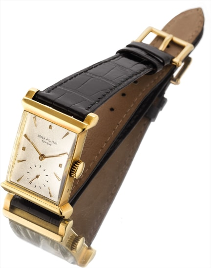 A fine yellow gold rectangular wristwatch with unusual lugs