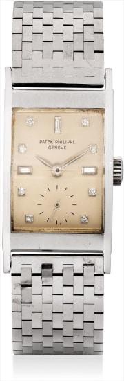 A rare platinum and diamond-set rectangular wristwatch with associated bracelet