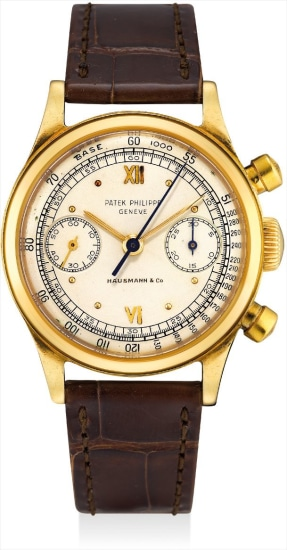 A fine and rare yellow gold chronograph wristwatch, retailed by Hausmann & Co.