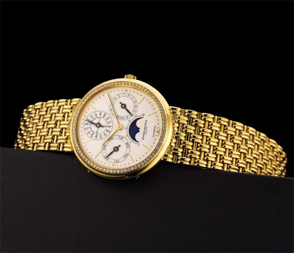 A fine and rare yellow gold and diamond set perpetual calendar bracelet watch with leap year indicator and moon phases