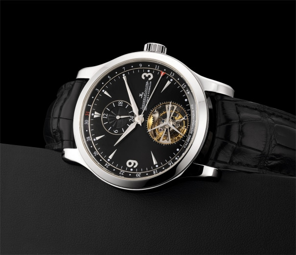 A fine and rare platinum limited edition dual time tourbillon wristwatch with date and black dial