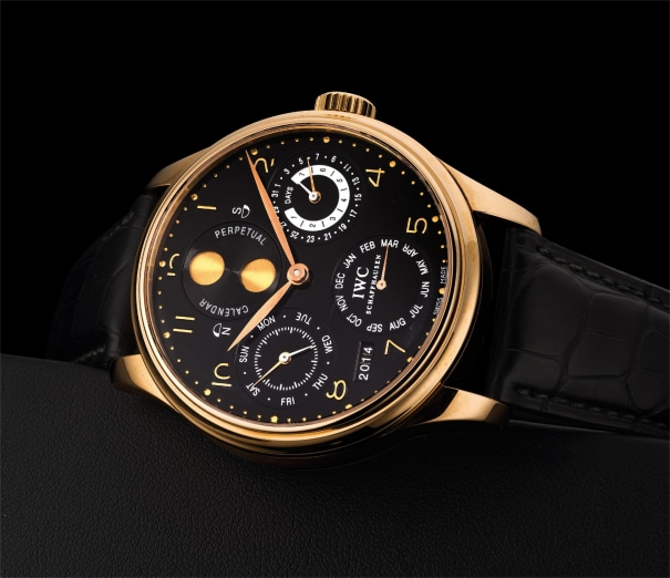 A fine and rare pink gold perpetual calendar wristwatch with moon phases, power reserve and digital year display