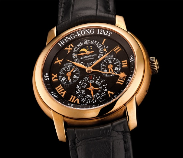 A fine pink gold perpetual calendar wristwatch with leap year indicator, sunset and sunrise display, moon phases and equation of time
