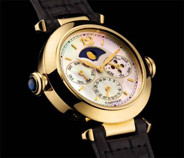 A fine and rare yellow gold minute repeating perpetual calendar wristwatch with moon phases, leap year indicator and mother-of-pearl dial