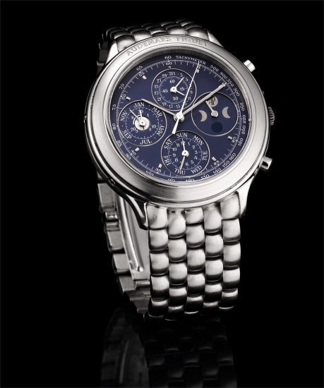 A fine and very rare platinum perpetual calendar chronograph bracelet watch with moon phases and leap year indicator