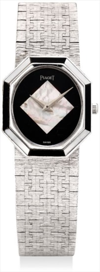 A fine and rare white gold, mother-of-pearl and onyx-set bracelet watch with onyx and mother-of-pearl dial