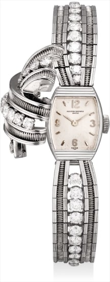 A lady's fine, very rare and unusual white gold and diamond-set bracelet watch with concealed dial