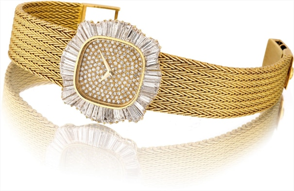 A lady's fine and possibly unique yellow gold and diamond-set bracelet watch
