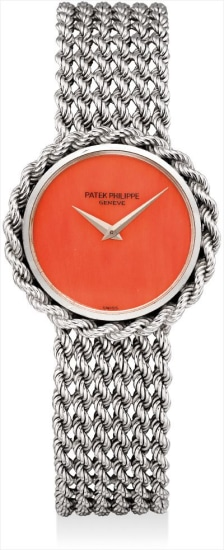 A lady's very rare white gold bracelet watch with coral dial