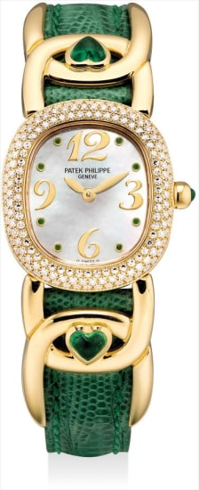 A lady's fine yellow gold, diamond and emerald-set wristwatch with mother-of-pearl dial