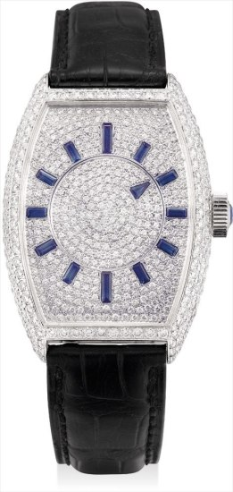 A fine white gold, diamond and sapphire-set tonneau-shaped wristwatch