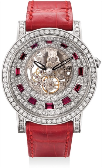 A fine and rare white gold, diamond and ruby-set skeletonised wristwatch