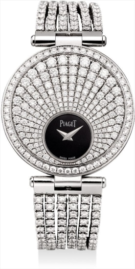 A lady's very fine and rare white gold and diamond-set reversible dual time double dialed bracelet watch