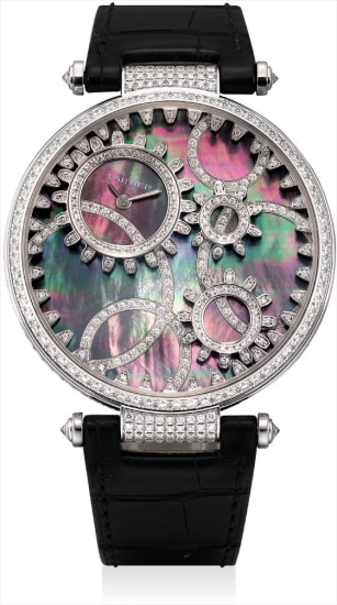 A lady's very fine and unusual white gold and diamond-set wristwatch with mother-of pearl and diamond-set gearwheel decorated rotatable dial